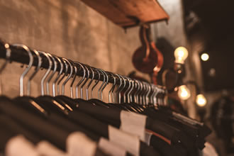pexels.com_-_photo-of-black-clothes-on-hangers-1036856.jpg